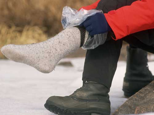 putting plastic bags on your feet
