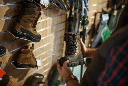 Man choosing boots for hunters